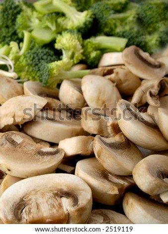 Mushrooms and broccoli on a dish - stock photo
