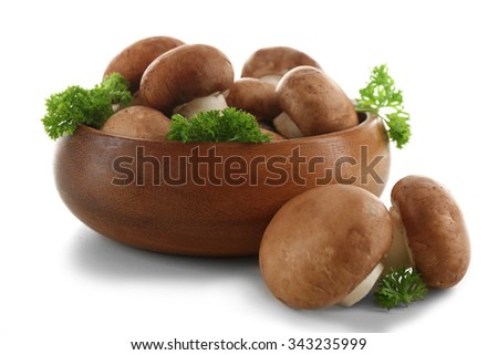 Mushrooms in bowl, isolated on white - stock photo