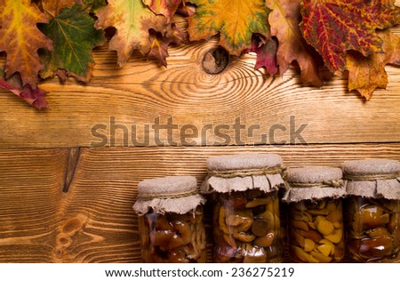 Mushrooms pickled in jars - stock photo
