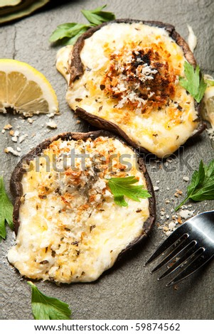 Mushrooms stuffed with four cheeses and topped with crispy panko bread crumbs