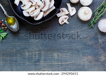 Mushrooms with olive oil, herbs and spices on dark wooden background with space for text. Vegetarian food, health or cooking concept. - stock photo