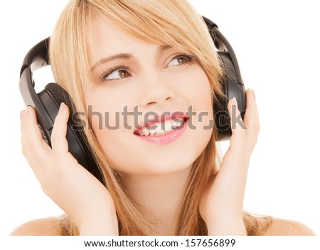 music and entertainment concept - happy girl with headphones - stock photo