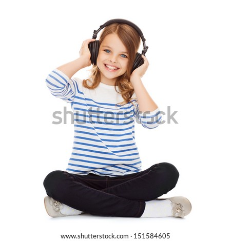 music and technology concept - child with headphones - stock photo
