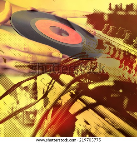 Music background - hands holding the vinyl  - stock photo