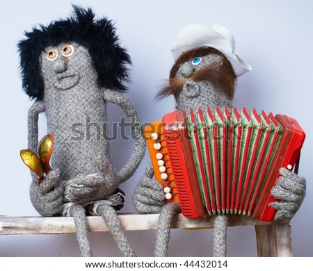 Music band from woman doll with spoons and man doll with accordion - stock photo