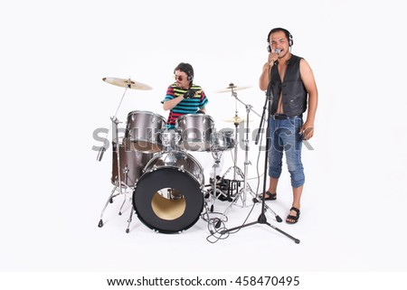 Music band in studio. Singer and drummer - stock photo