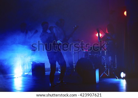 Music band performing on stage. - stock photo