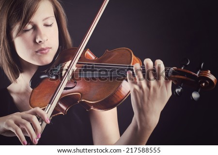 Music. Beautiful girl with violin - stock photo