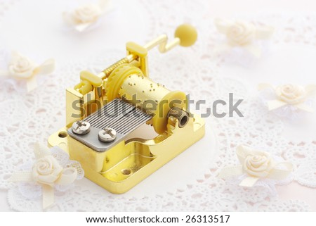 Music box on lace paper - stock photo