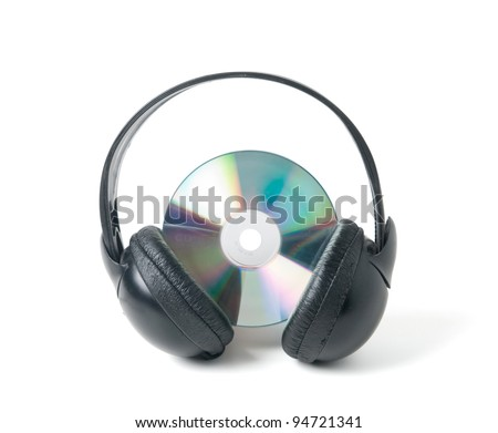 Music CD and headphones Isolated on a white background. Clipping path. - stock photo