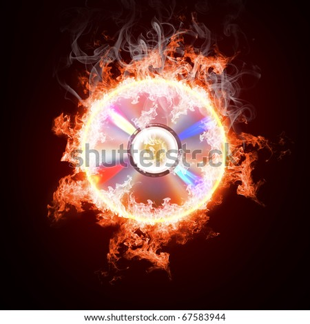 Music CD in open fire on a black background - stock photo