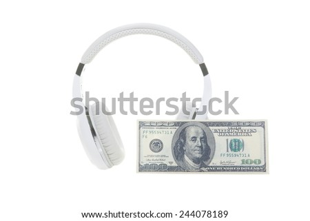 Music concept. Headphones and banknote - isolated on white - stock photo
