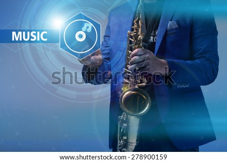 Music concept. musician with a saxophone icon clicks on the virtual display
