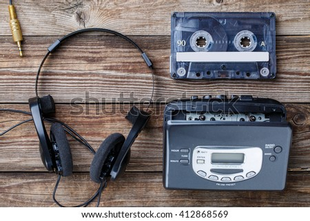Music concept. Top view of cassette tape, audio player and headphones. - stock photo