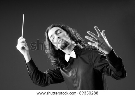Music concept with passionate conductor - stock photo
