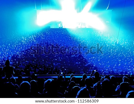 Music concert with many visitors and spectacular lightning - stock photo