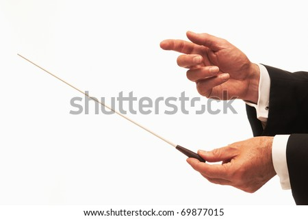 Music conductor hands with baton isolated on white background - stock photo