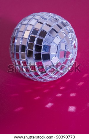 music disco ball on pink background, light reflections - stock photo
