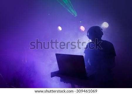 Music Dj mixing at nightclub party - stock photo