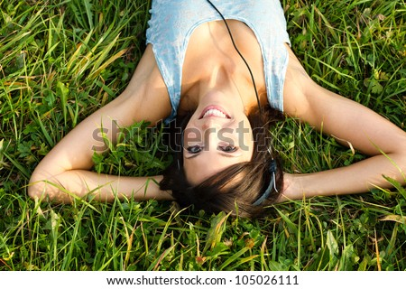 music in meadow - stock photo