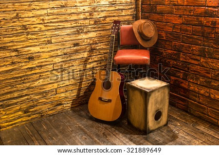 Music instruments on wooden stage - stock photo