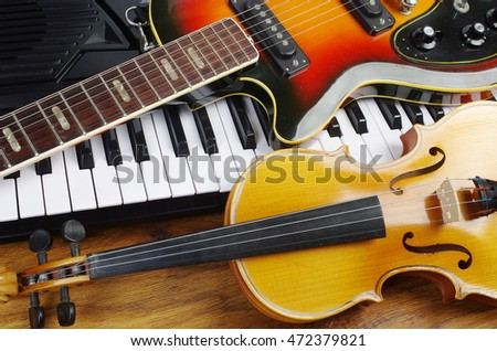 Music instruments.Synthesizer, violin and electric guitar