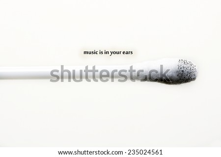 music is in your ear conceptual image with space for sample text - stock photo