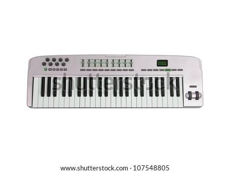 Music keyboard isolated on white - stock photo