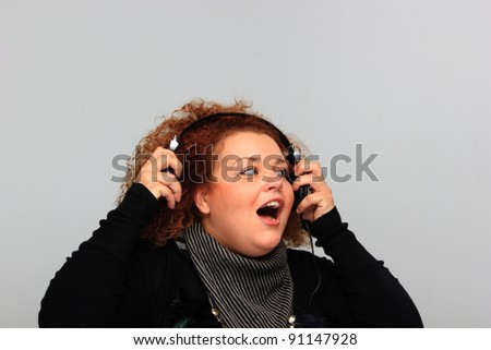 Music Listening Girl on neutral background