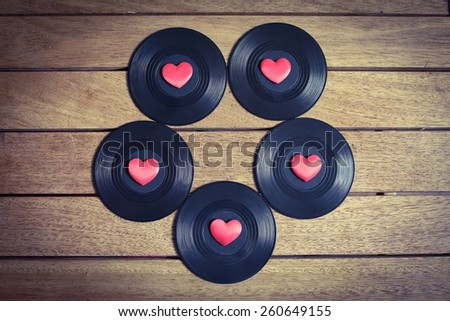 Music Lover - Albums with red love hearts on a wooden surface - stock photo