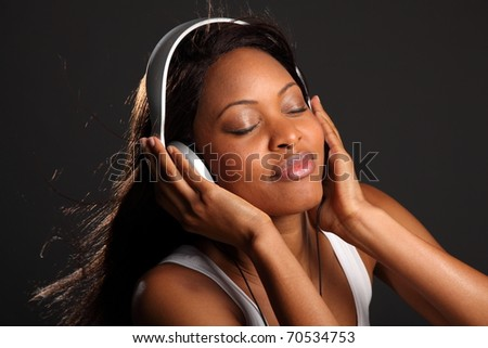 Music lover eyes closed listening on headphones - stock photo
