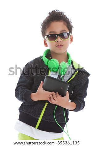 Music.  Mixed race boy wearing headphones and holding a tablet.  Isolated on white. - stock photo