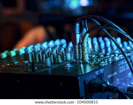Music Mixer at nightclub with connected wires - stock photo