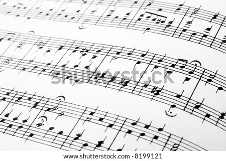 Music notes abstract background, detail of a music sheet. - stock photo