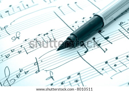 music notes and pen