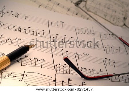 music notes and pen and glasses - stock photo