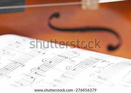 Music notes and violin close up