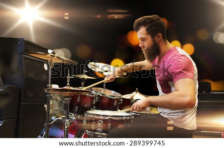 music, people, musical instruments and entertainment concept - male musician playing cymbals at rock concert - stock photo