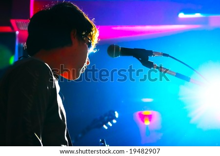 music performer on scene in nocturnal club - stock photo
