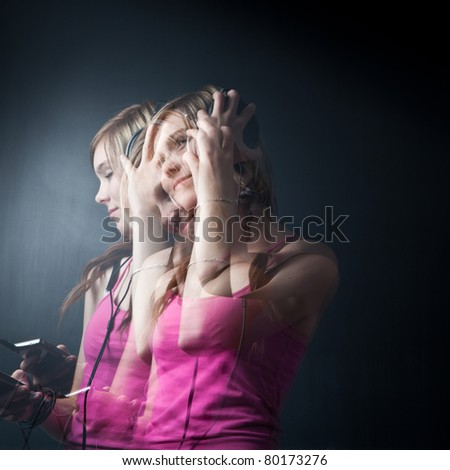 Music please! - Portrait of a pretty young woman/teenager listening to music on her hi-end headphones, enjoying the groove (multiple exposure shot) - stock photo
