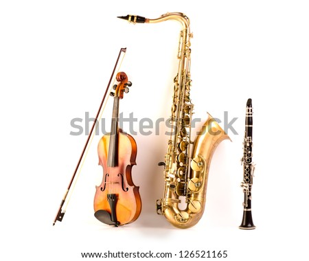 Music Sax tenor saxophone violin and clarinet in white background - stock photo