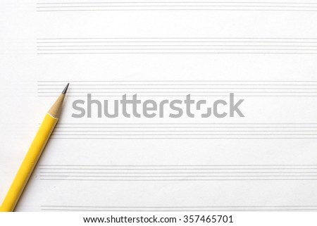 Music sheet and yellow pencil - stock photo