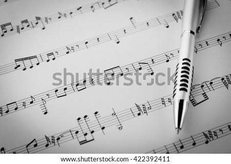 music sheet paper background the pen on music sheet note paper background.Write song or compose music concept.compose this music sheet note paper by myself. - stock photo