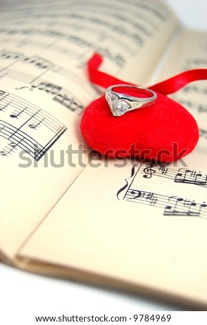 Music sheet with fabric heart and ring