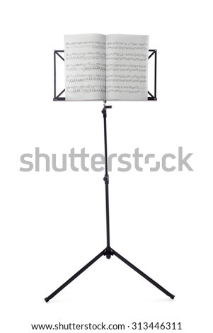 Music sheets on stand isolated on white - stock photo