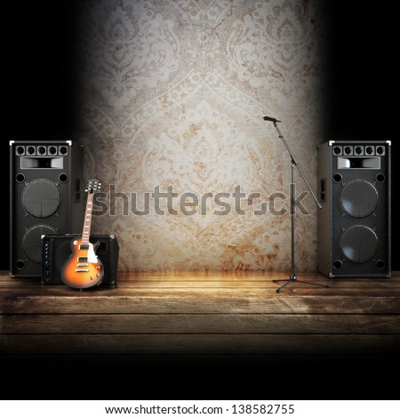 Music stage or singing background, microphone, guitar and speakers with wood flooring. Advertising concept with room for text or copy space - stock photo