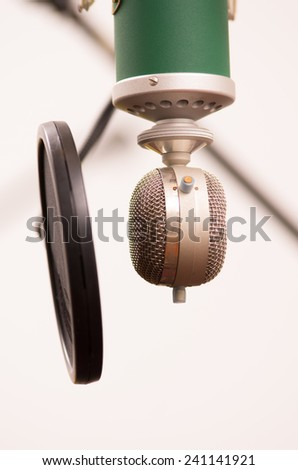 music studio microphone with pop filter closeup - stock photo