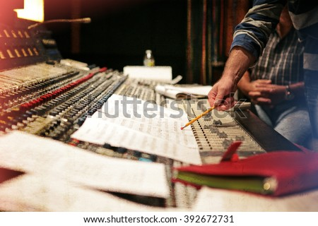 Music studio. Orchestrating record music album. Vintage old look with scratches and worn out retro look - stock photo