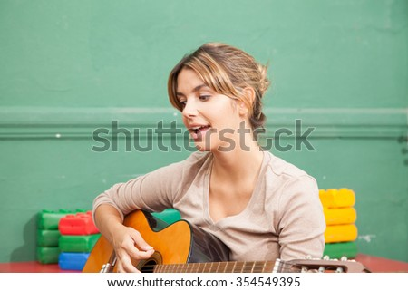 Music teacher in the kindergarten