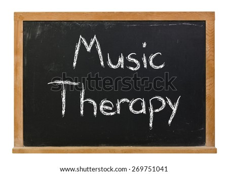 Music Therapy written in white chalk on a black chalkboard isolated on white  - stock photo